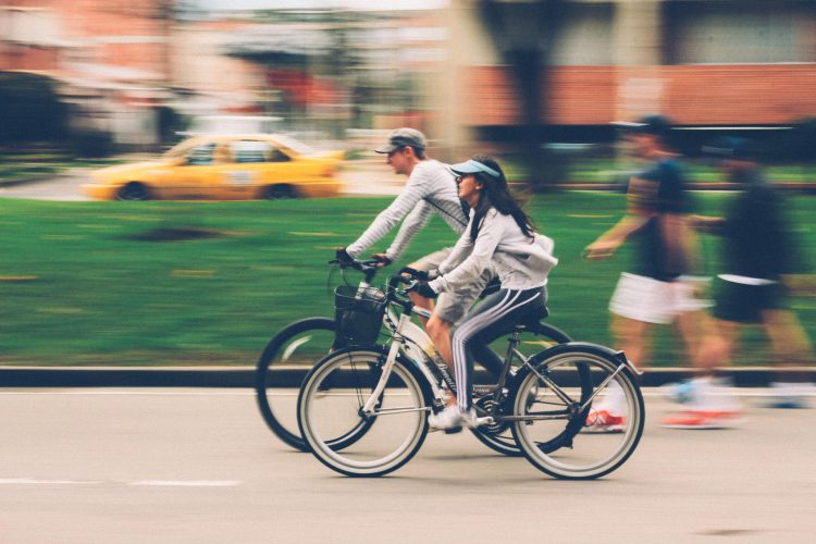 Two people riding to see how far electric bikes can go